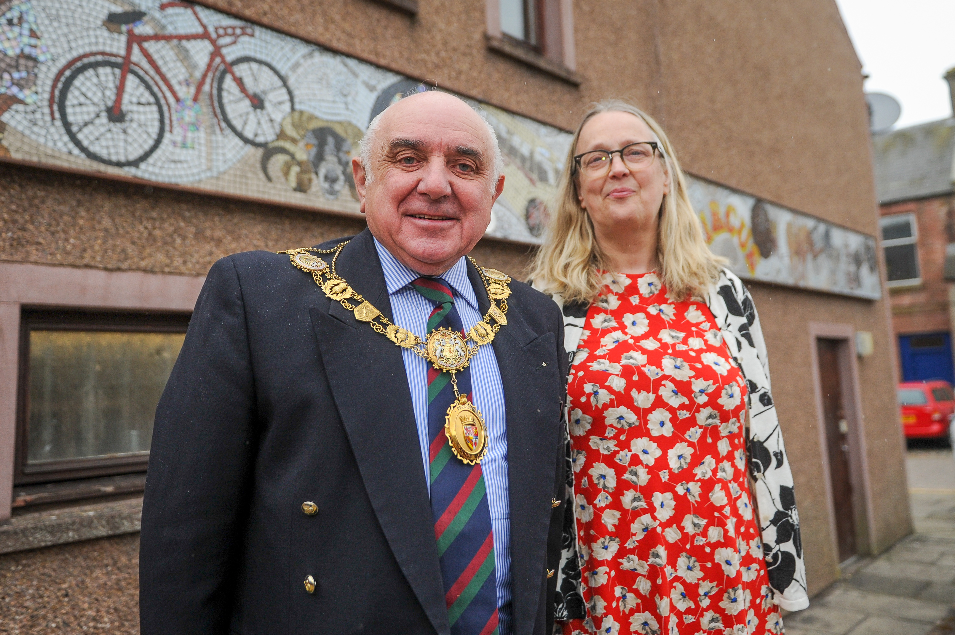 Angus Provost Ronnie Proctor and artist, Maureen Crosbie with the Cumberland Close mosaic