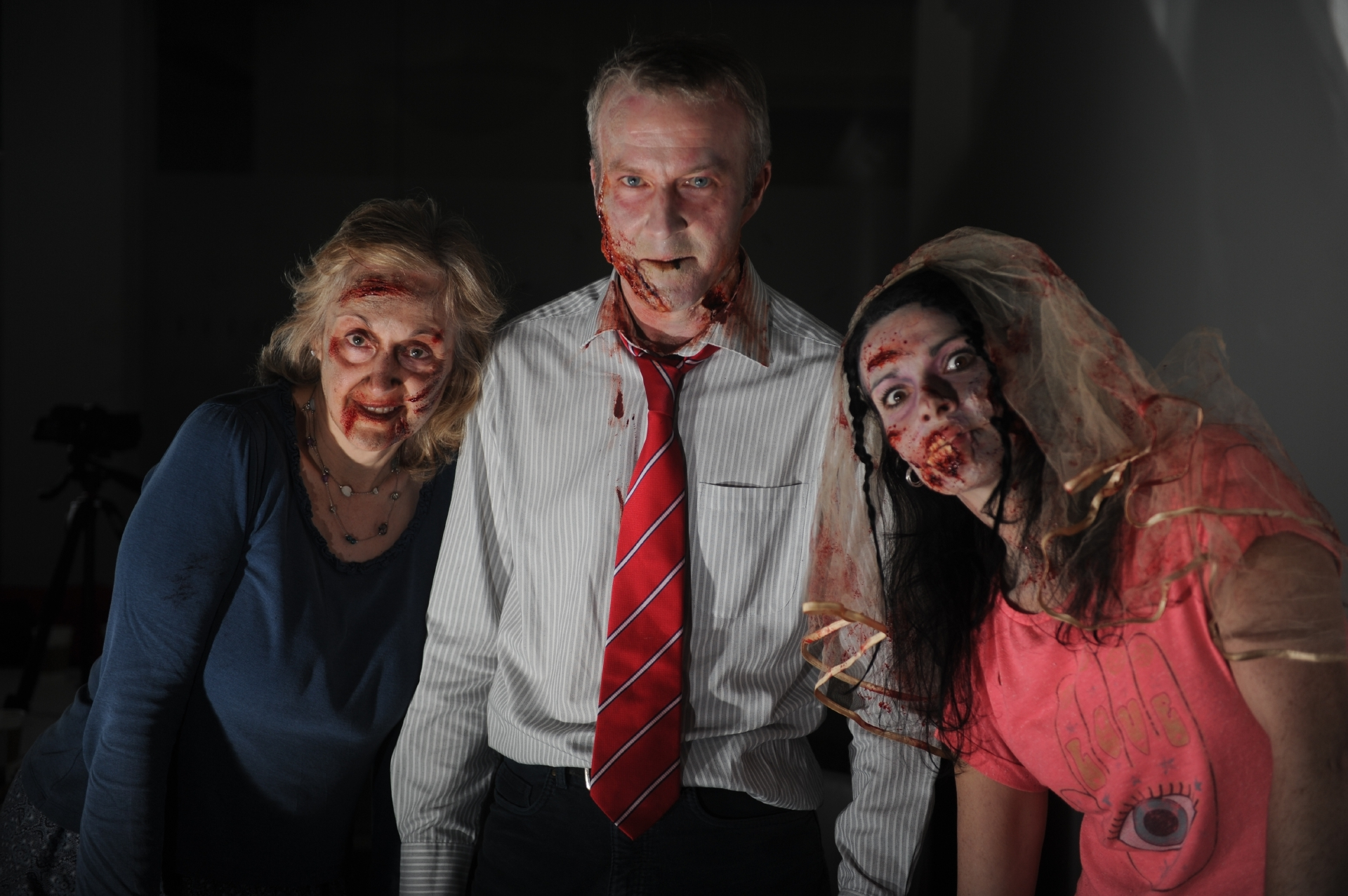 The Courier's Caroline Lindsay, Mike Alexander and Gayle Ritchie ready for their zombie wedding.