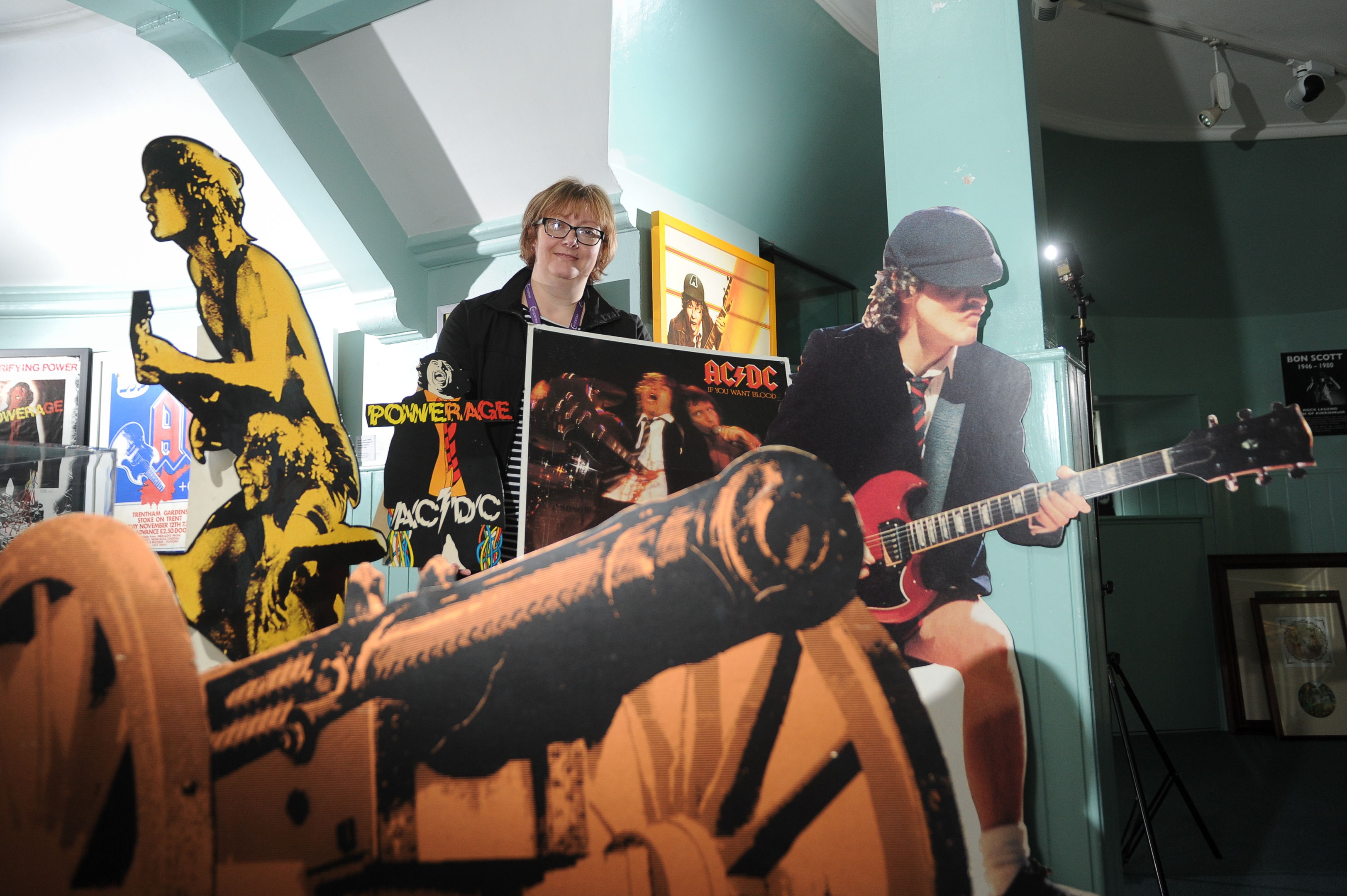 Museum officer Rachel Jackson with memorabilia from the Bon Scott exhibition being staged for this weekend's Bonfest