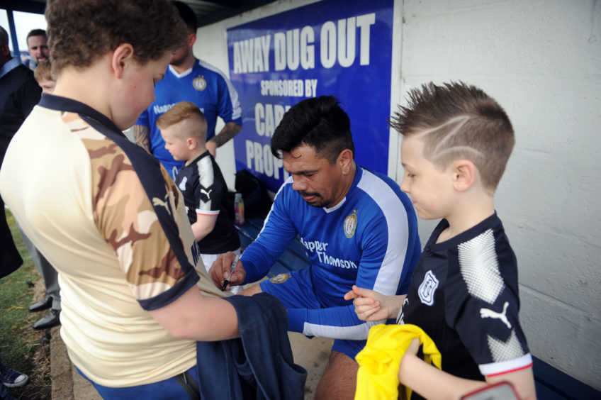 Caballero signs shirts for young fans