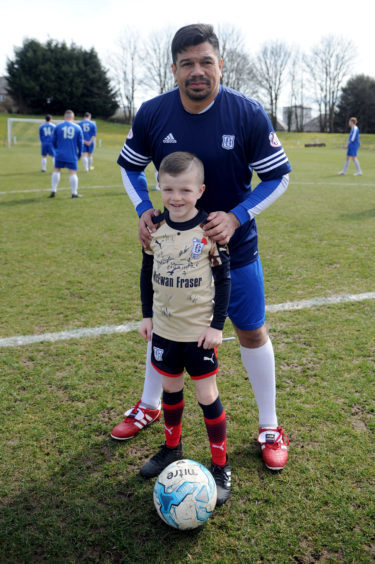 Fabian Caballero and the mascot for the game, Kai Rennie (8)