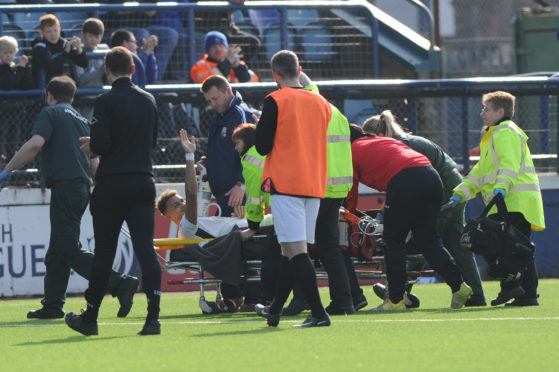 Brave Ousman See beckons to the fans as he is stretchered off.