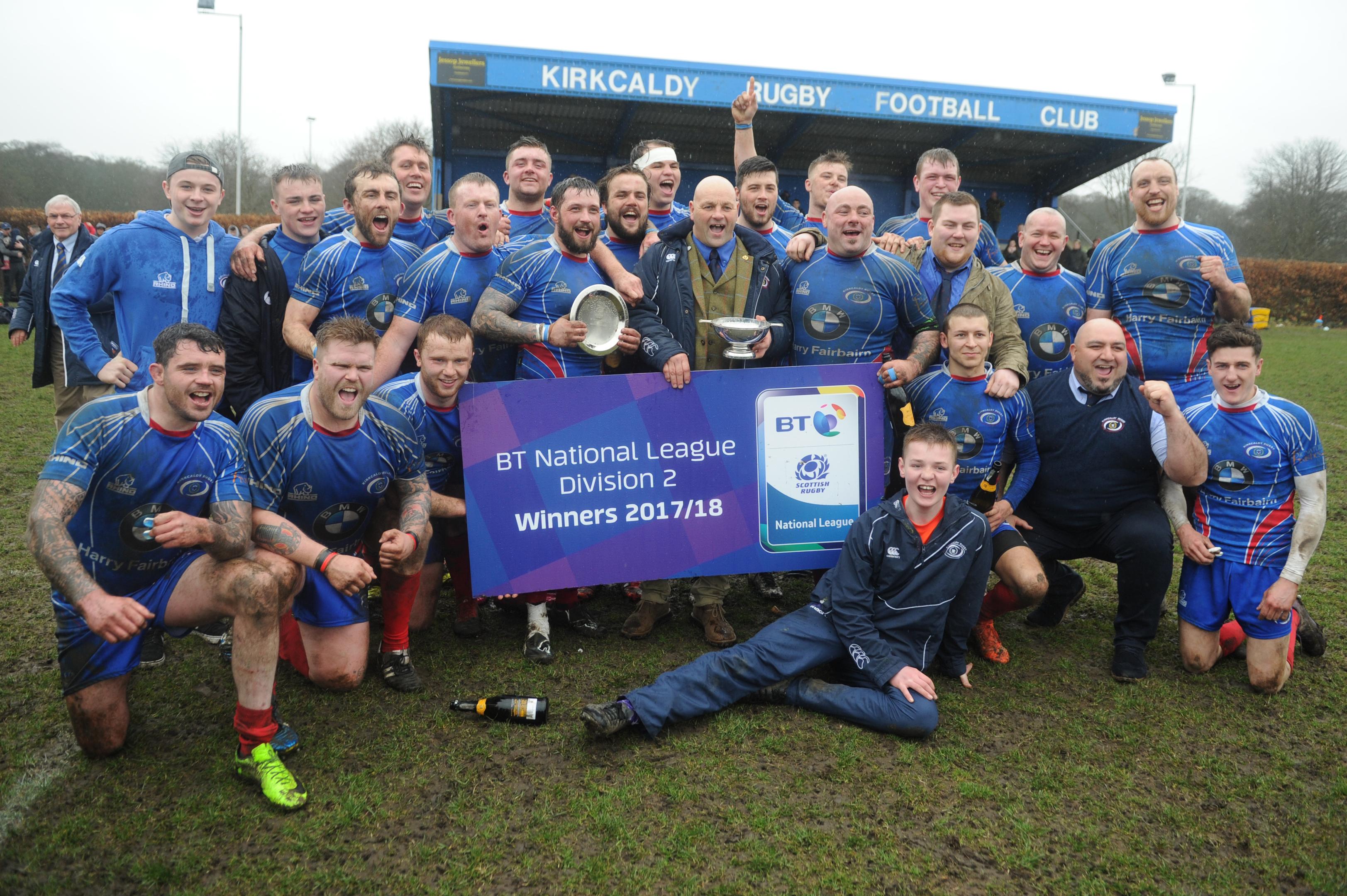 Club president Jimmy Bonner with the National keague Two Trophy and the victorious Kirkcaldy team.