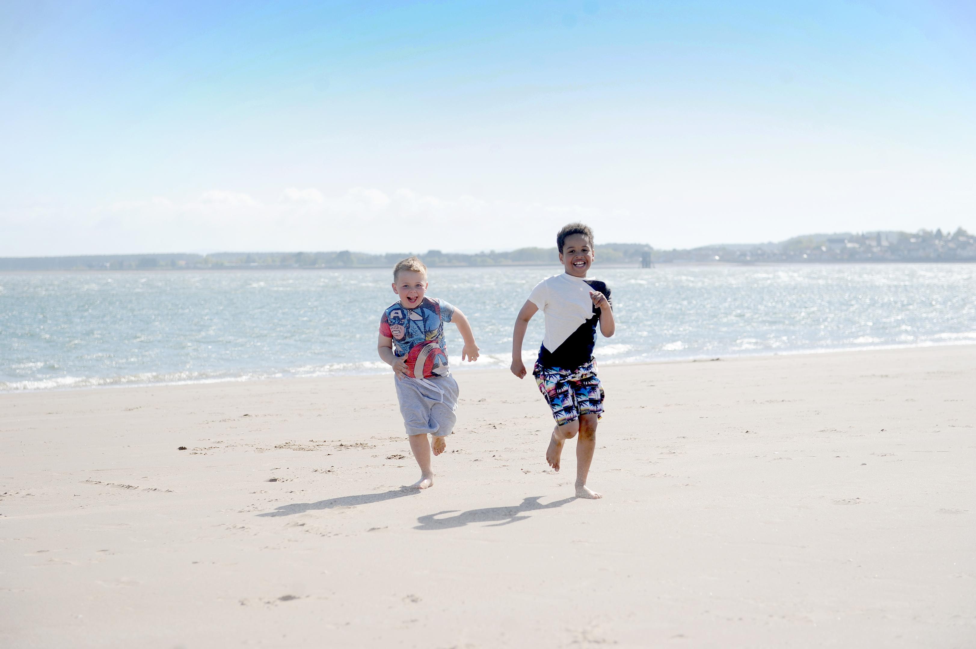 Reilly Fraser and Morris Muzividzi enjoying the sun at Broughty Beach in May 2017.