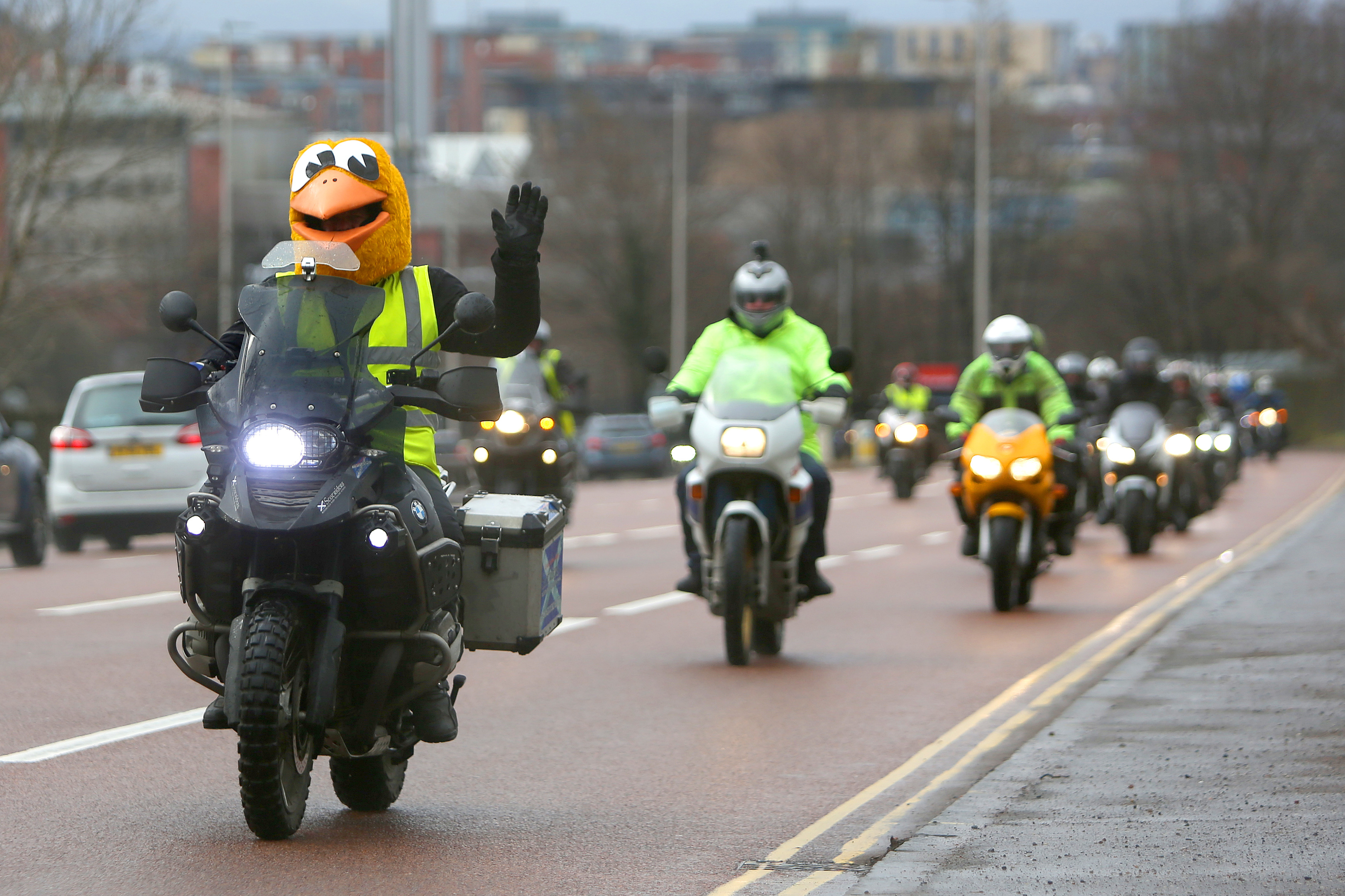 Alan Kelly from Scotriders leading motorbikes leaving Scotriders with a police escort.