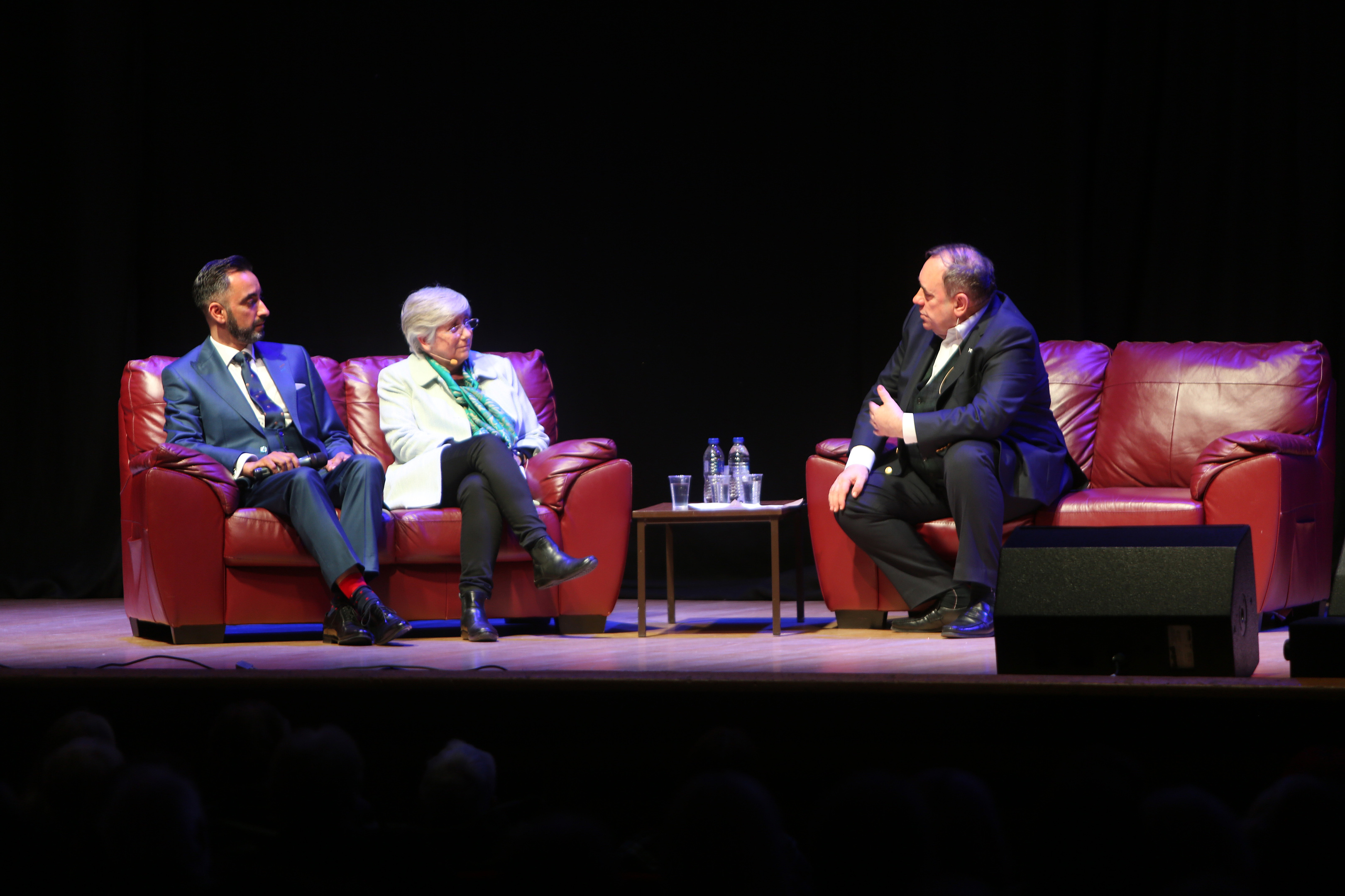 Alex Salmond on stage with Prof Clara Ponsati (Catelonia politician and St Andrews Uni lecturer) and her legal representative Aamar Anwar at Caird Hall, Dundee.