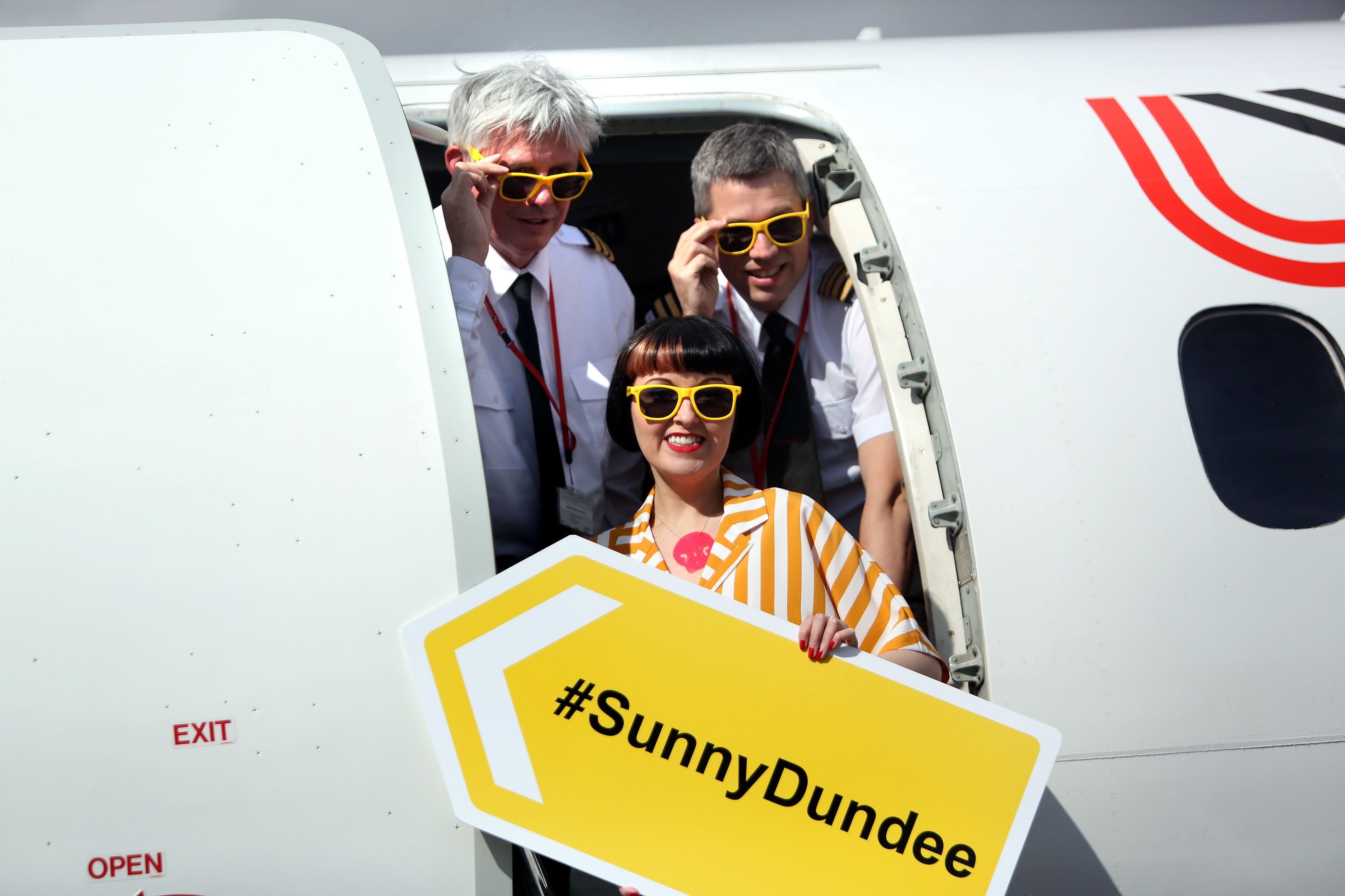Cpt Mike Cryle, First Officer Peter Nugent and V&A Dundee design champion Kirsty Stevens on the Logan Air flight at Dundee Airport.