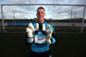 Forfar Athletic 'keeper Marc McCallum gets his hands on a bottle of the FAFC 1984 limited edition gin during a training session at Station Park.