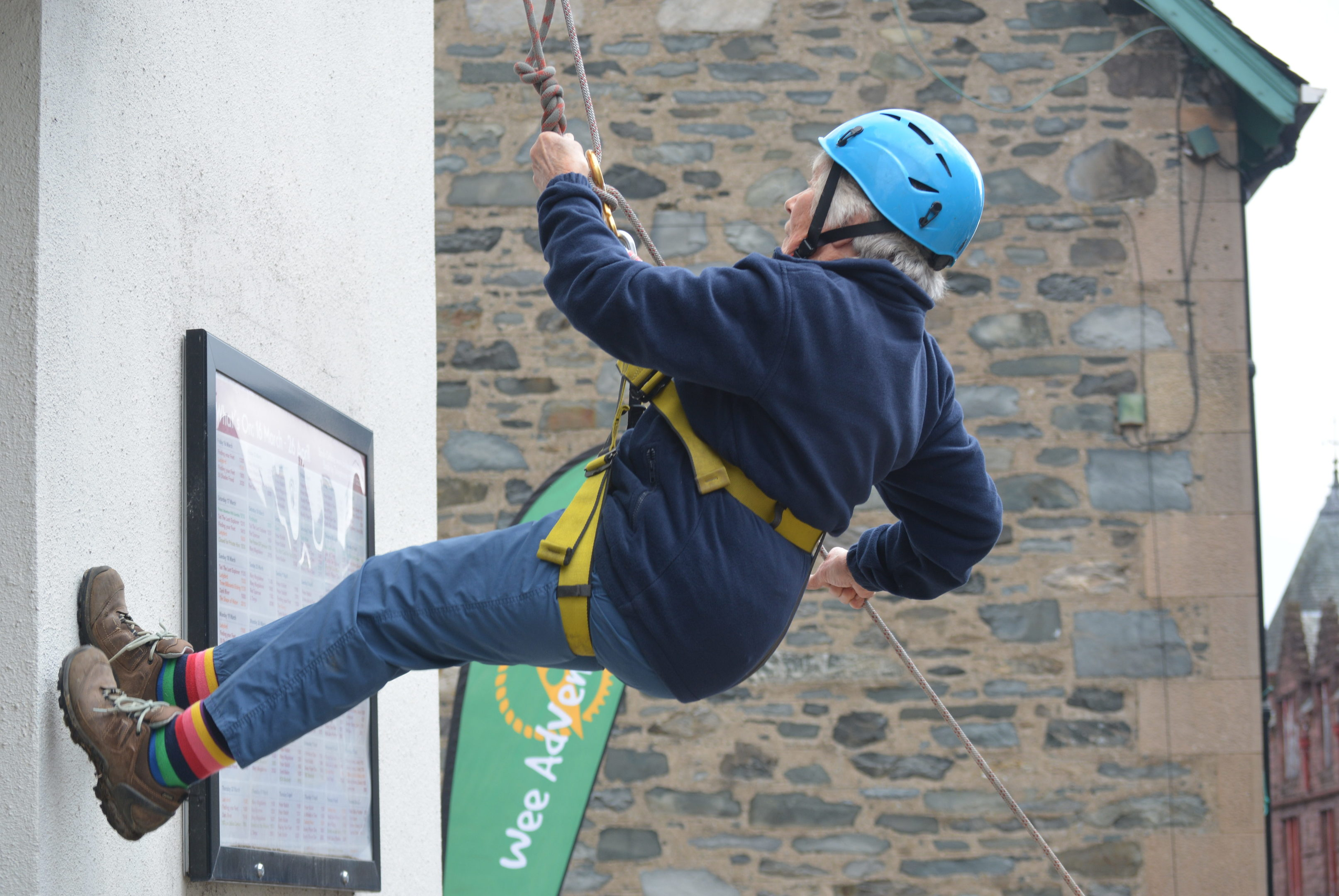 Eighty-year-old Margaret Jarvis abseils down The Birks Cinema.