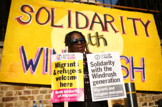 People attend an event in Windrush Square, Brixton, south London, organised by Stand up to Racism in solidarity with the Windrush generation and their families.