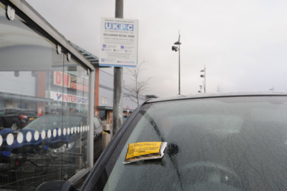 A parking ticket issued in Gallagher Retail Park.