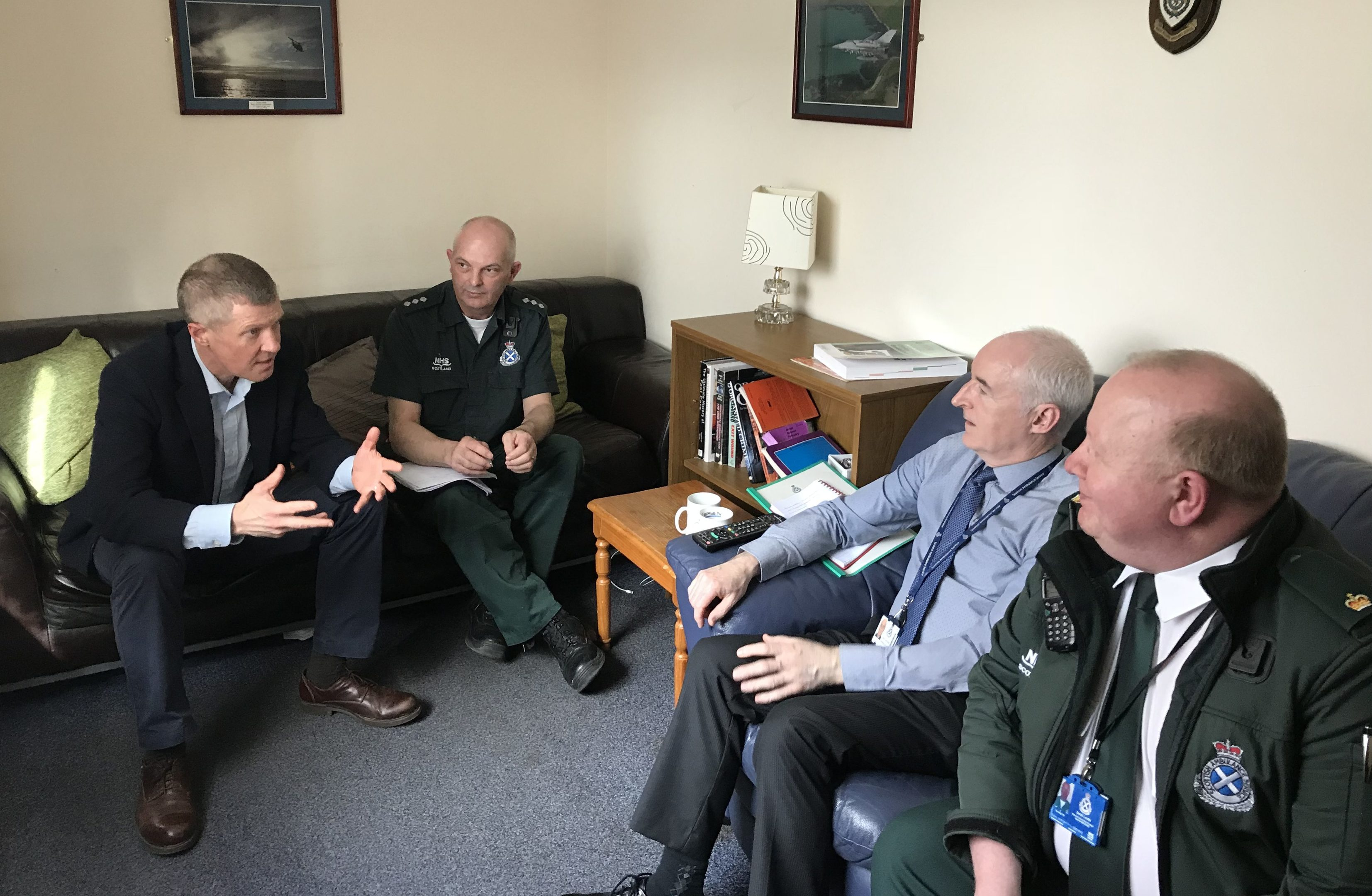 Mr Rennie with representatives of the service  including Derek Louttit, national clinical risk manager, and Lewis Campbell, regional director for the Scottish Ambulance Service east division.