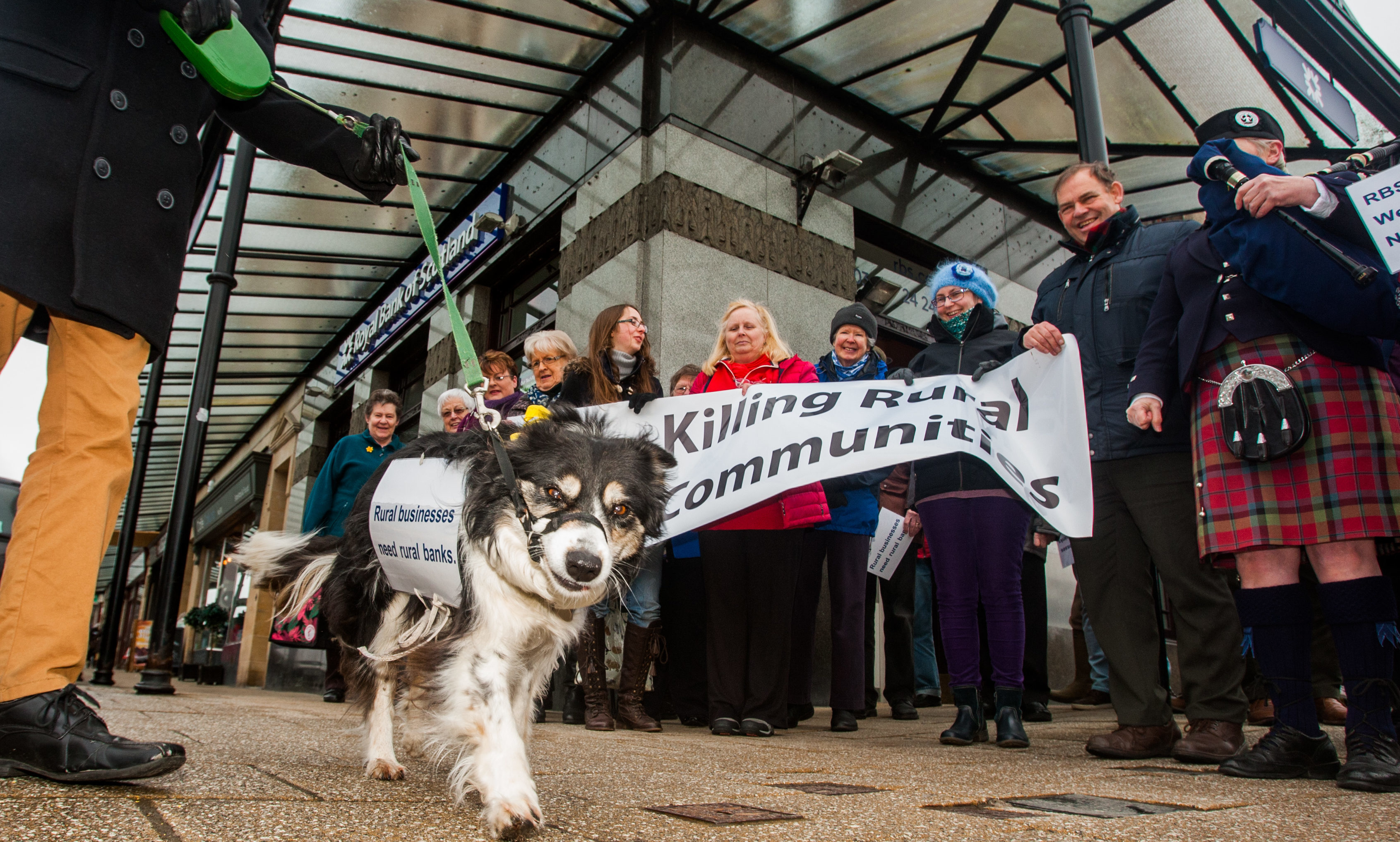 Demonstrators gather for the protest outside the closure threatened Piltochry branch of RBS.