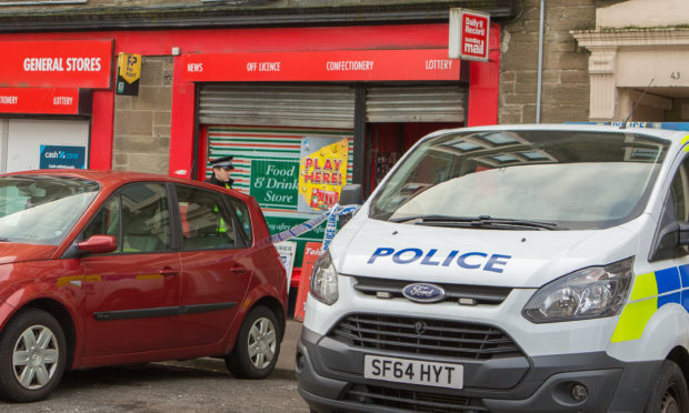 Police at the General Stores in Dundonald Street when it was targeted by a robber in November 2017.