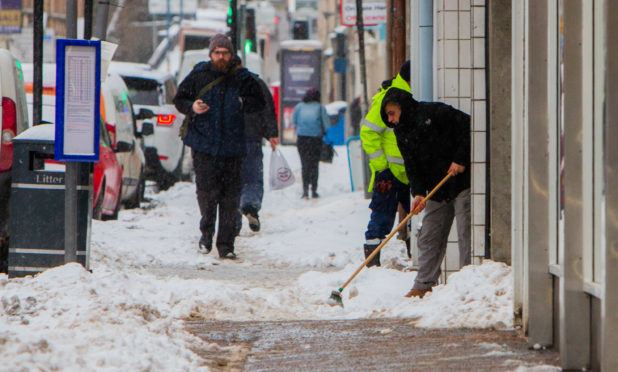 Pavements in South Street, Perth, being cleared of snow during the Beast from the East weather blast.