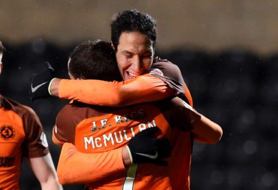Bilel Mohsni is congratulated by fellow goalscorer Paul McMullan.
