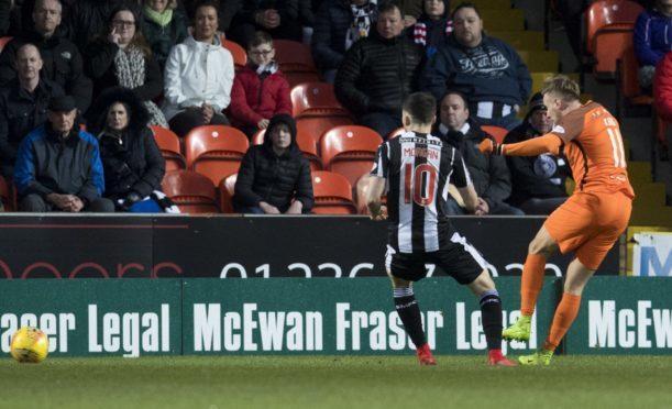 Billy King scores against St Mirren.
