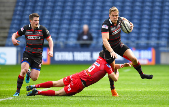 Duhan van der Merwe charges through tackles for his first try at Murrayfield.