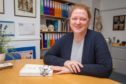 Professor Dame Sue Black in her old office with her award winnig book All That Remains.