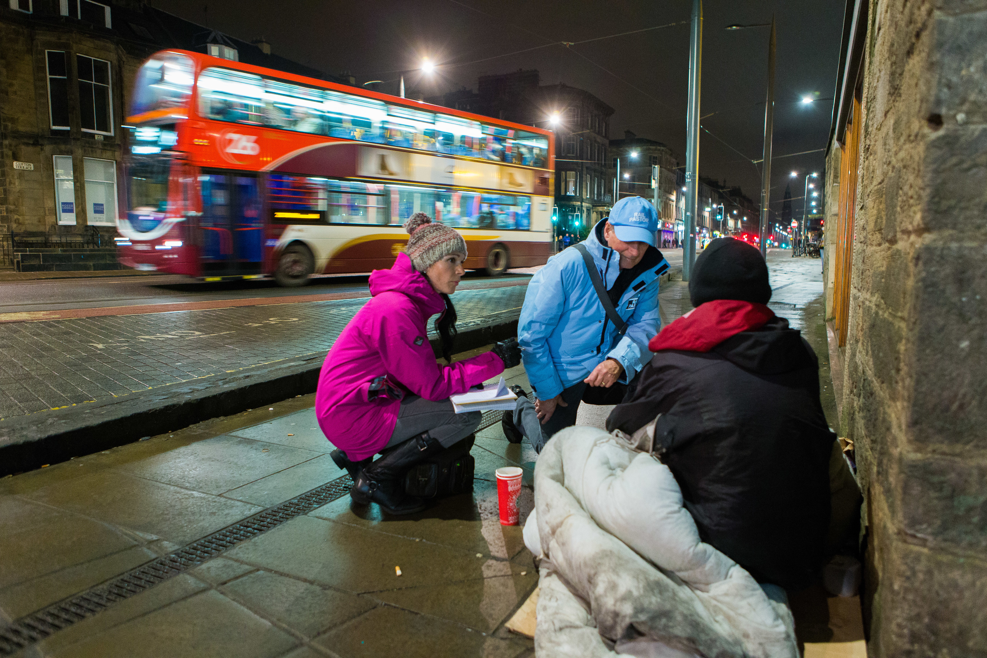 Rail Pastor Moss Barclay speaks to homeless man Colin Todd (31) as he settles down for the night while chatting to Courier Reporter, Gayle Ritchie telling his story.