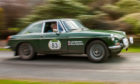 Julia and Steve Robertson set off in their MG B GT.