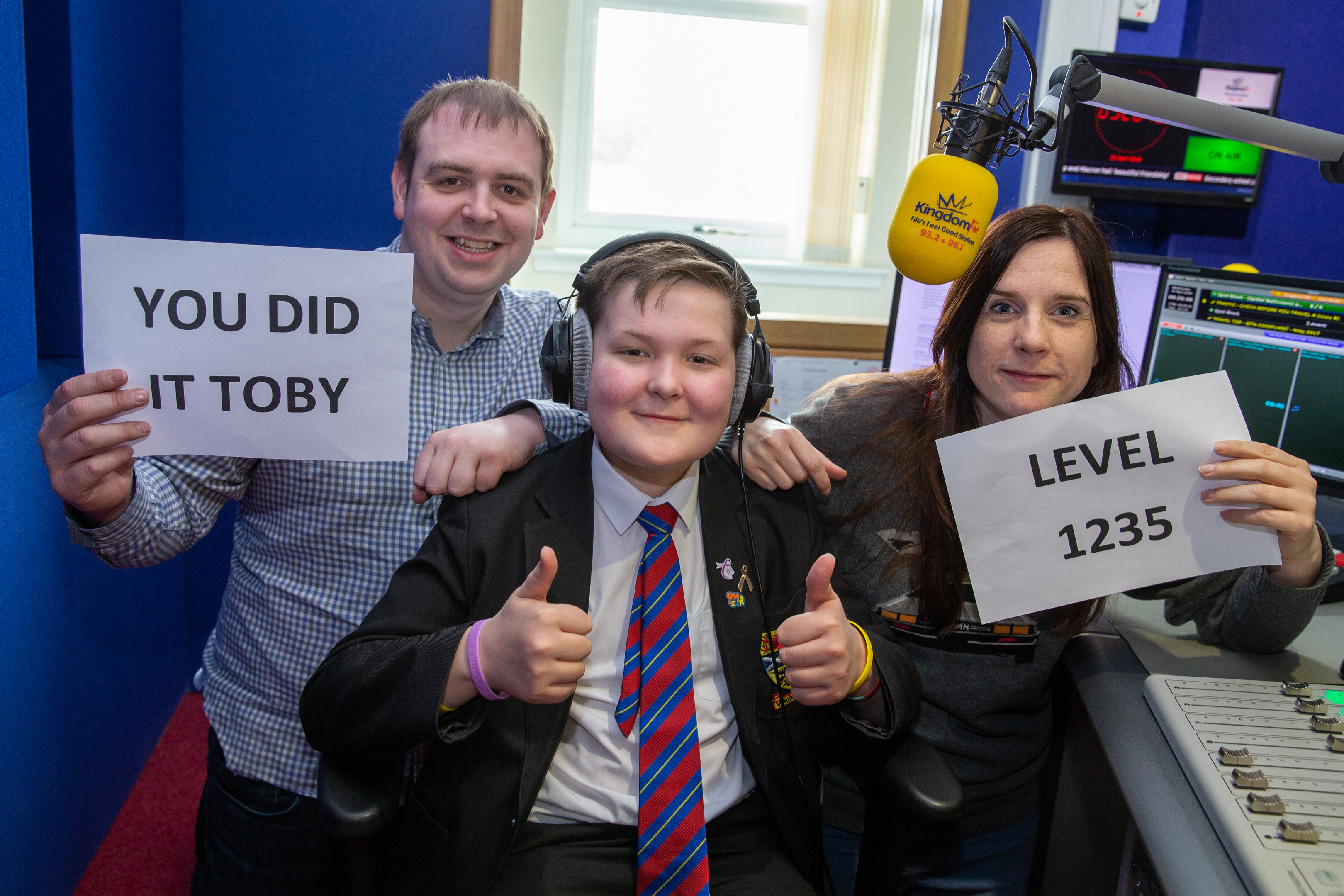Toby Etheridge celebrates being in remission from his cancer with a visit to his friends at Kingdom FM today, including breakfast presenters Dave Connor and Vanessa Motion.