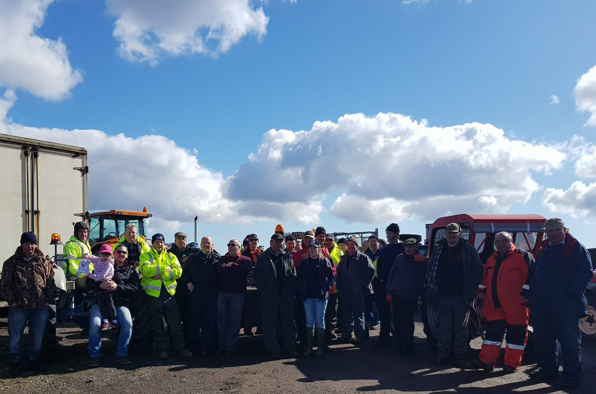 Participants take a break during the tractor run.