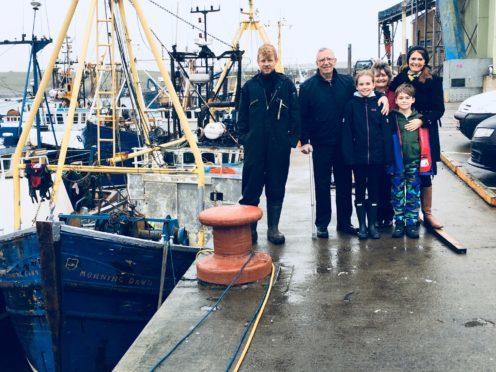 From left, Stewart Curren, current skipper, Jim Swankie, Jim's granddaughter Adriana Schofield, Jim's wife Jane Swankie, Jim's grandson Aaron Schofield and Jillian Schofield, Jim's daughter.