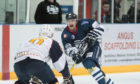 Dundee Stars player Brian Hart goes one-on-one with the Flames' Tomas Nechala
