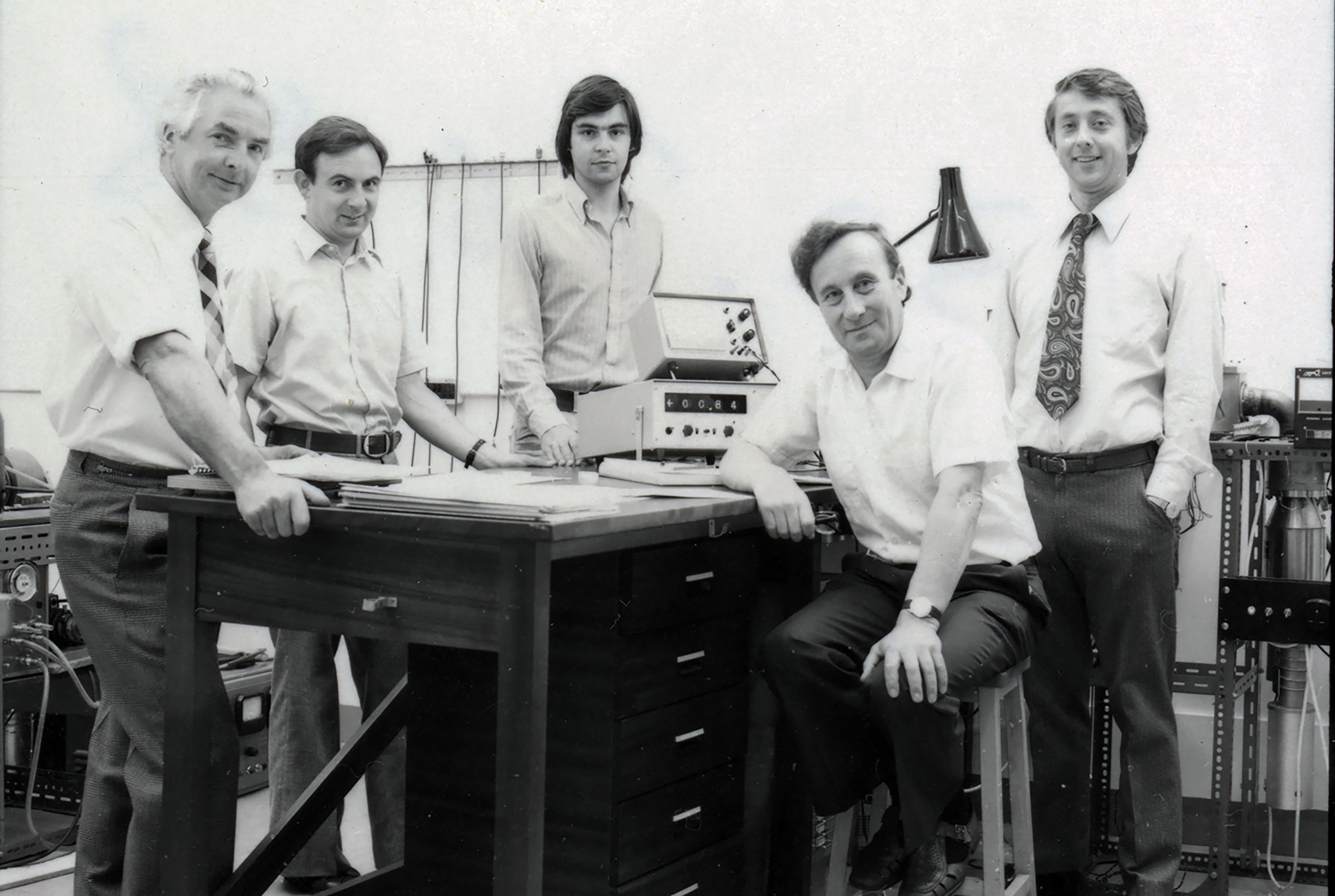 Professor Spear (seated second from right) and Professor LeComber (standing, far right) and research group in the 1970s.