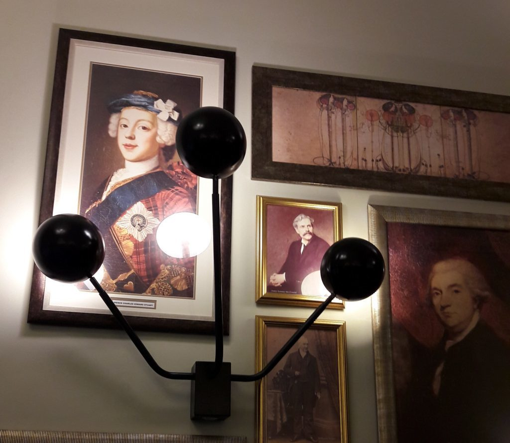 Paintings next to the Hotel Indigo grand staircase