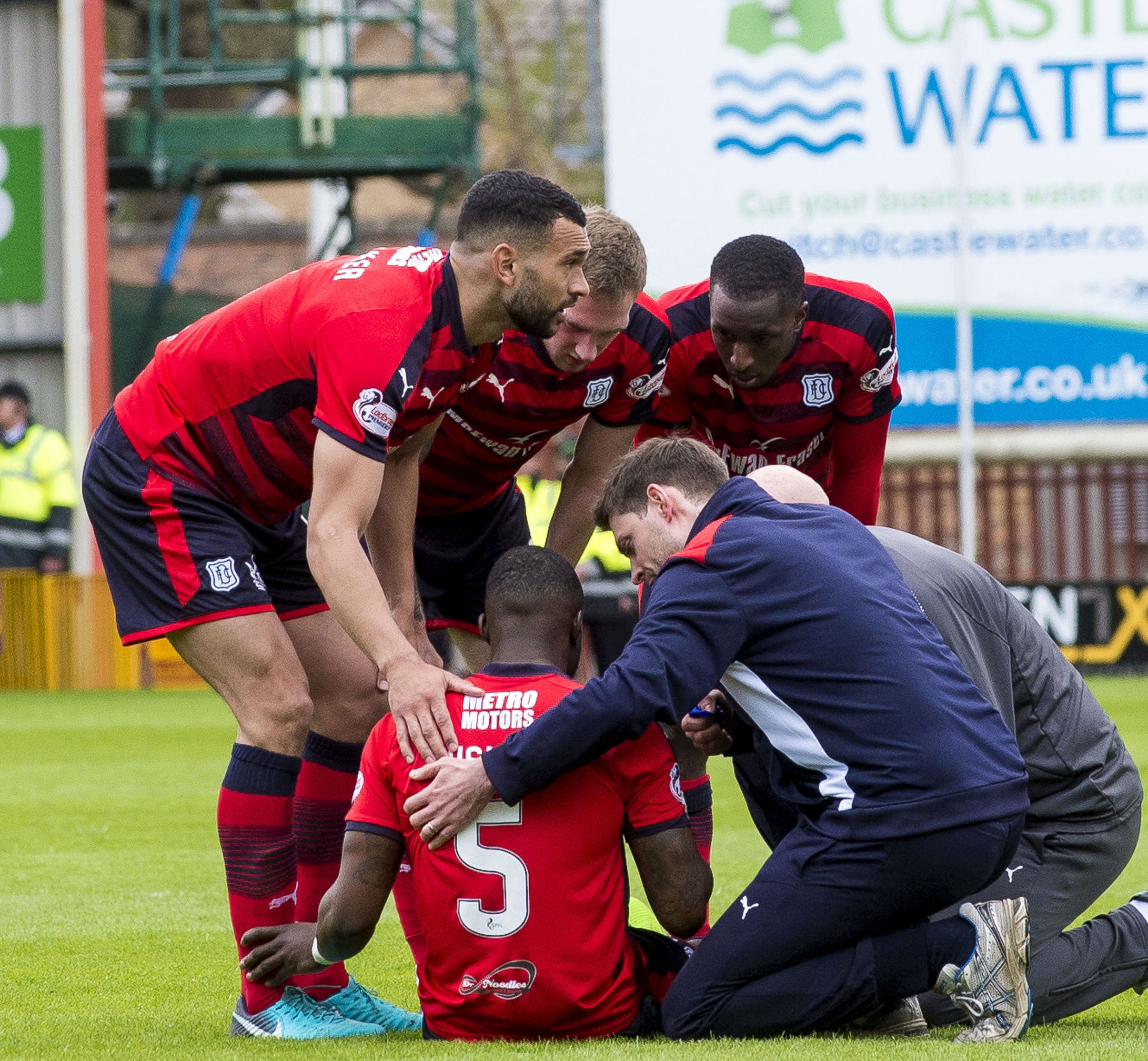 Dundee's Genseric Kusunga before being stretchered off.