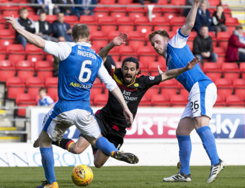 Ryan Edwards goes down for the Thistle penalty.