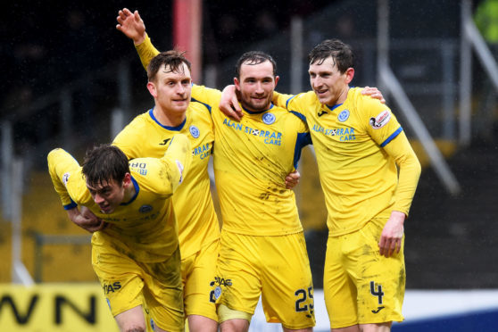 Liam Craig helps Chris Kane celebrate one of his goals at Dens.