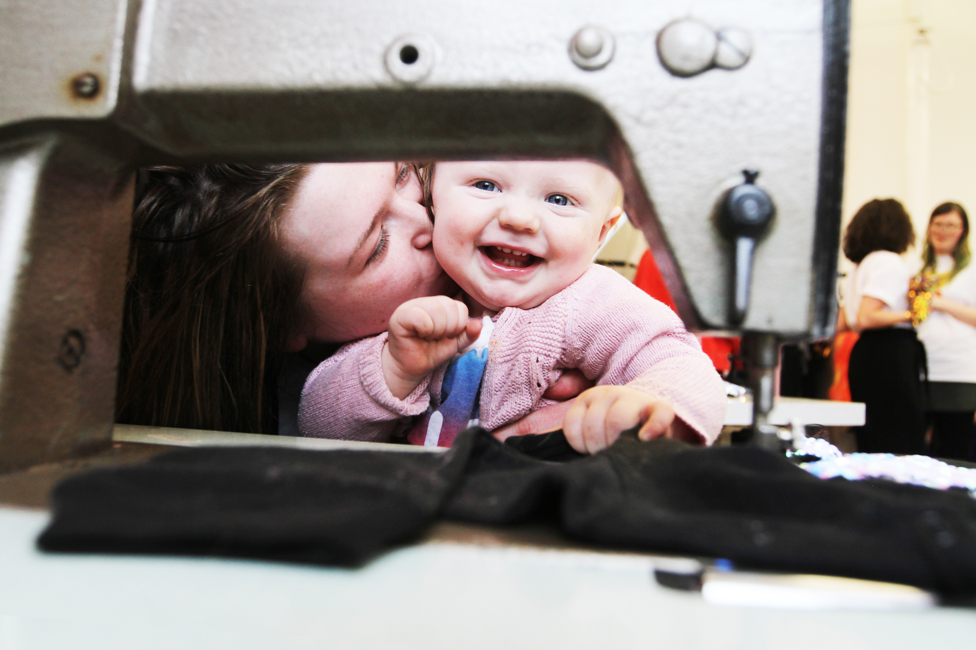 Zoe Smith with Tilly Fox, 1, getting to grips with the sewing machines.
