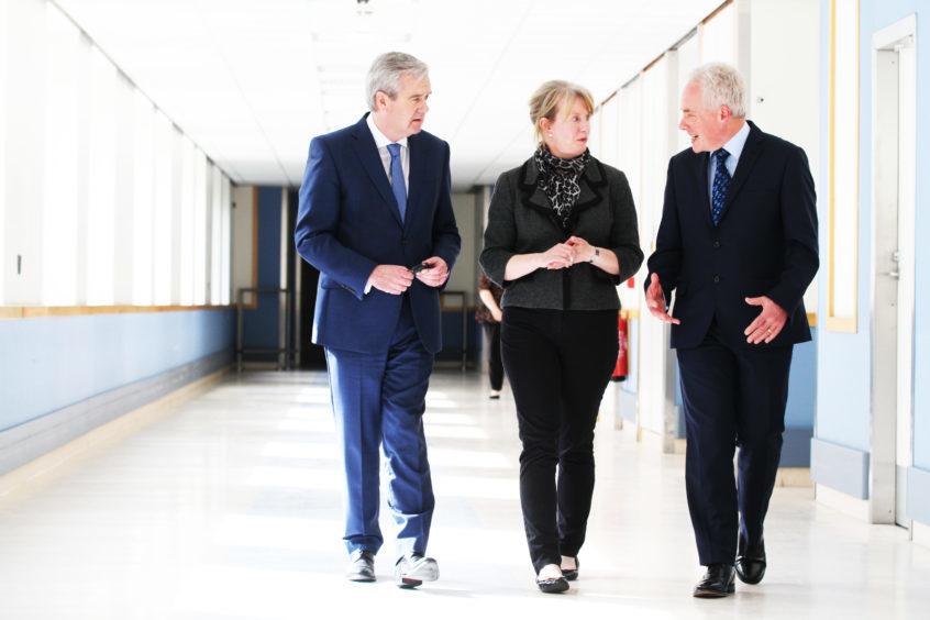 John Brown, interim chairman, health secretary Shona Robison and the new NHS Tayside chief executive Malcolm Wright.