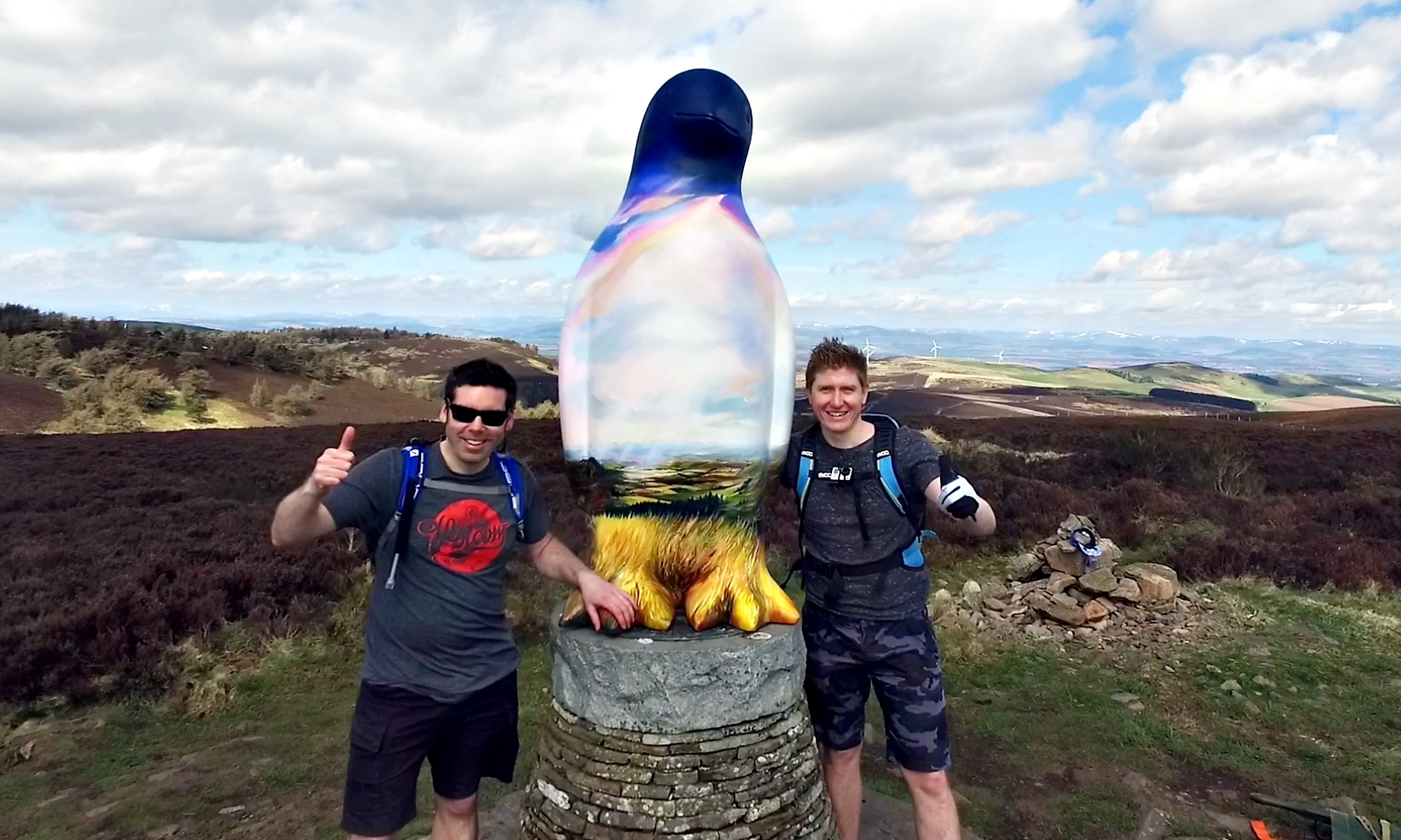 Richard Main, left, and Douglas Roulston celebrate getting Sid the Penguin to the summit of Balkello Hill.