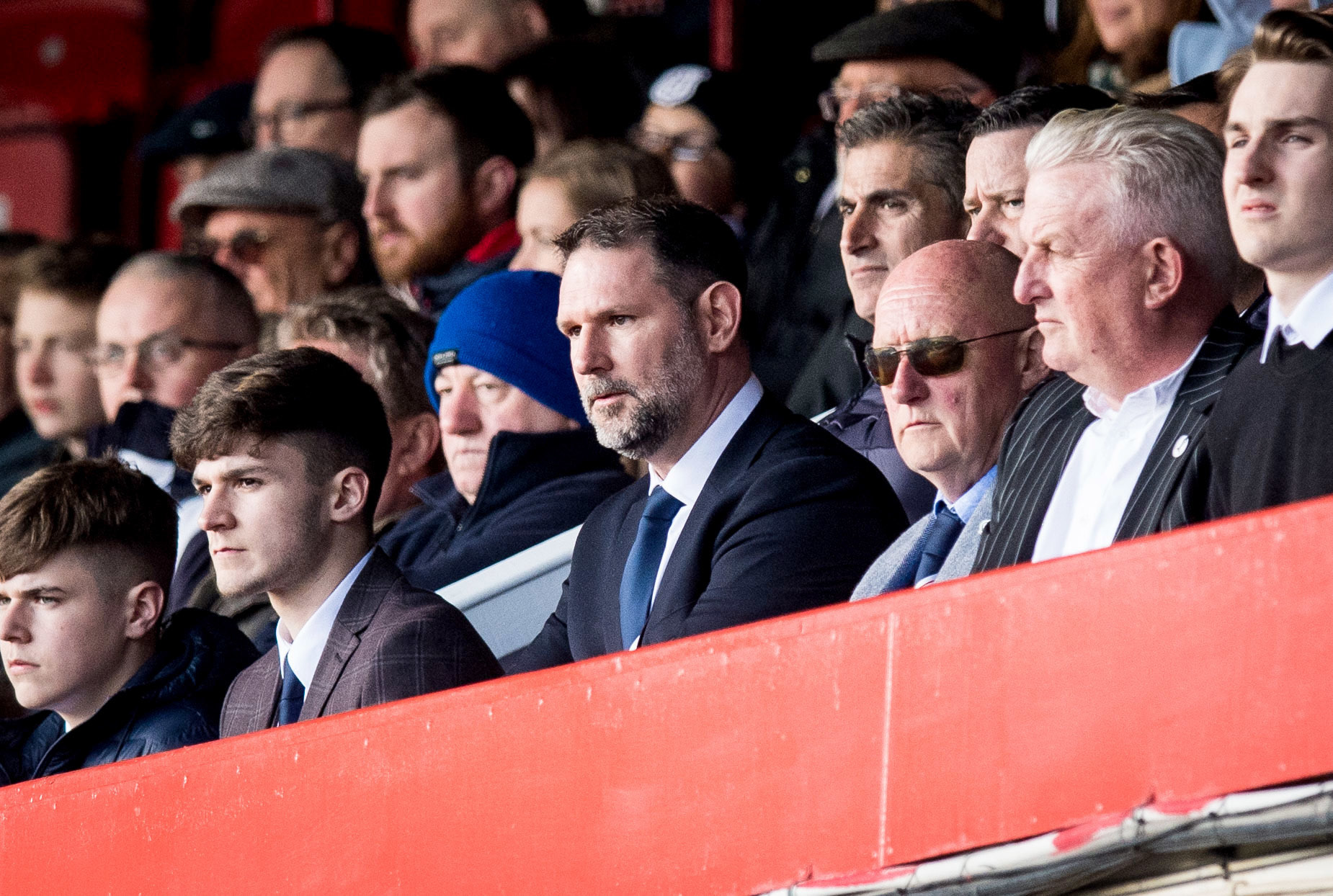 Dundee managing director John Nelms (centre)