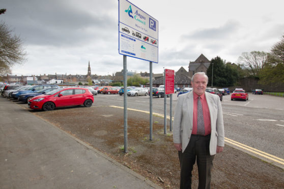 Angus depute Provost Colin Brown says council staff and teachers should pay for parking
