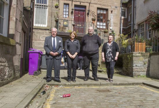 Councillor Colin Brown (left) with Dawn McFarlane of the Osnaburg Bar, Neil MacKay of The Pend Emporium and Jacqui Robb of Auntie Jacquis before they set about cleaning up the street.