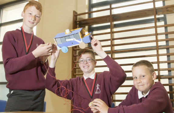 Senior competition winners from Northmuir Secondary School David Lawrie, Andrew Peters and Struan White with their winning creation.