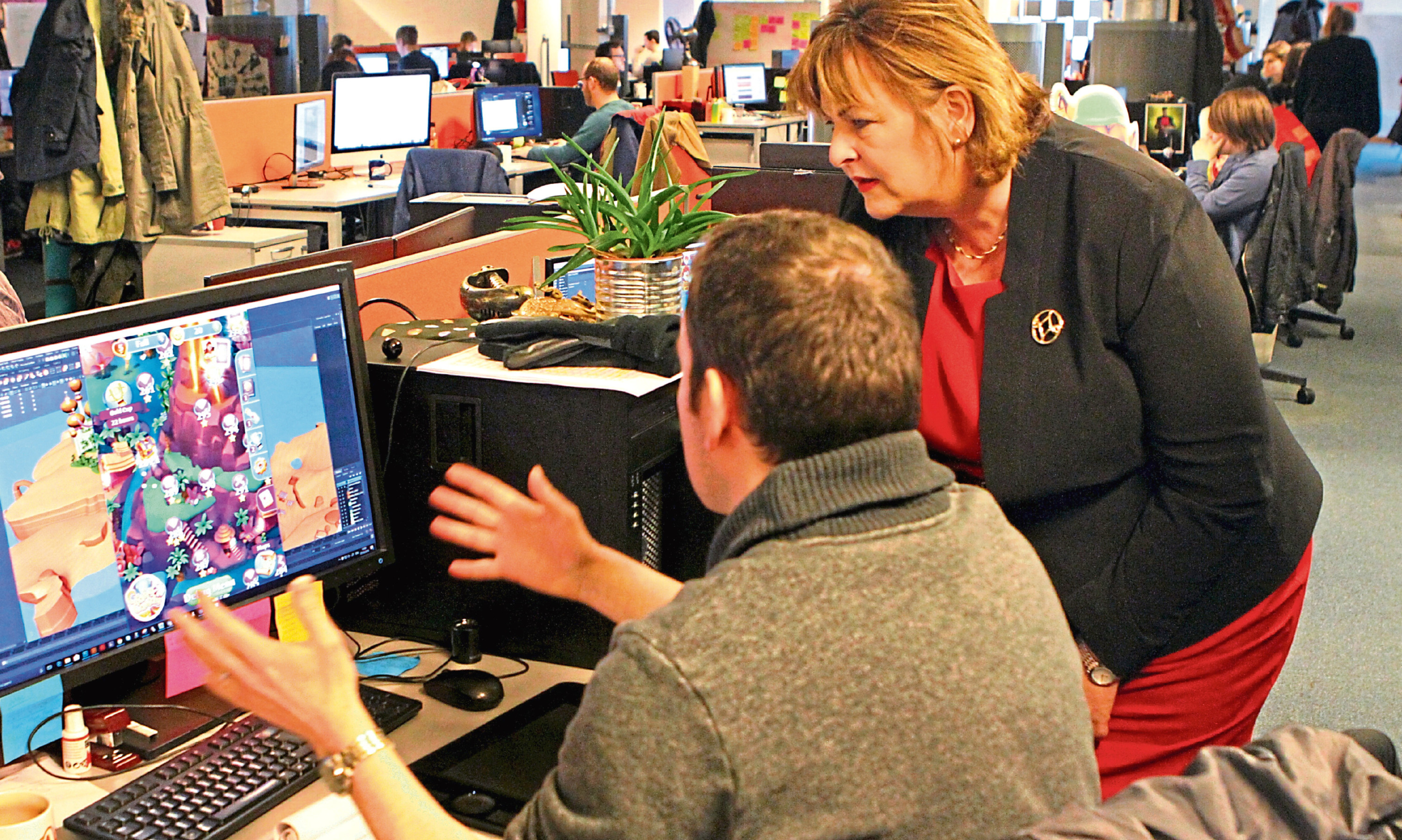 External affairs secretary Fiona Hyslop is shown the latest game under design at Outplay Entertainment in Dundee. Above: tech entrepr
