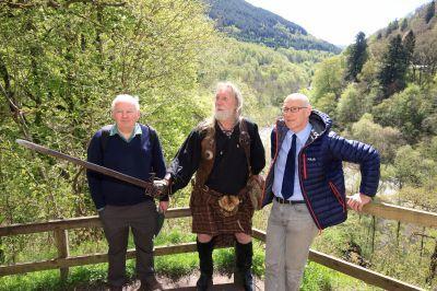 Battle of Killiecrankie expert James Rattray (left) gives John Swinney (right) a tour with enactor John Neilson