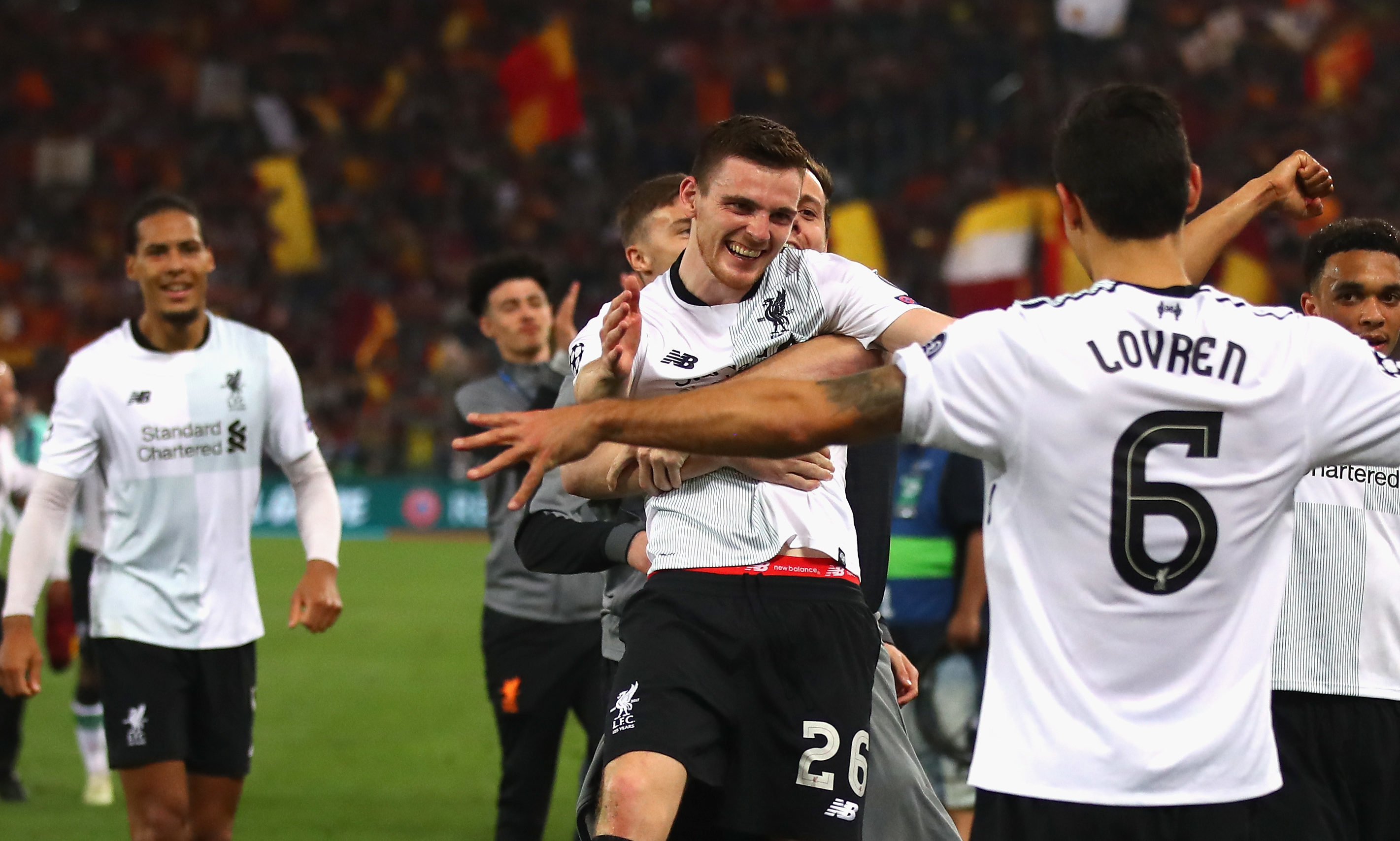 Andy Robertson of Liverpool and teammates celebrate after the full time whistle as Liverpool qualify for the Champions League Final