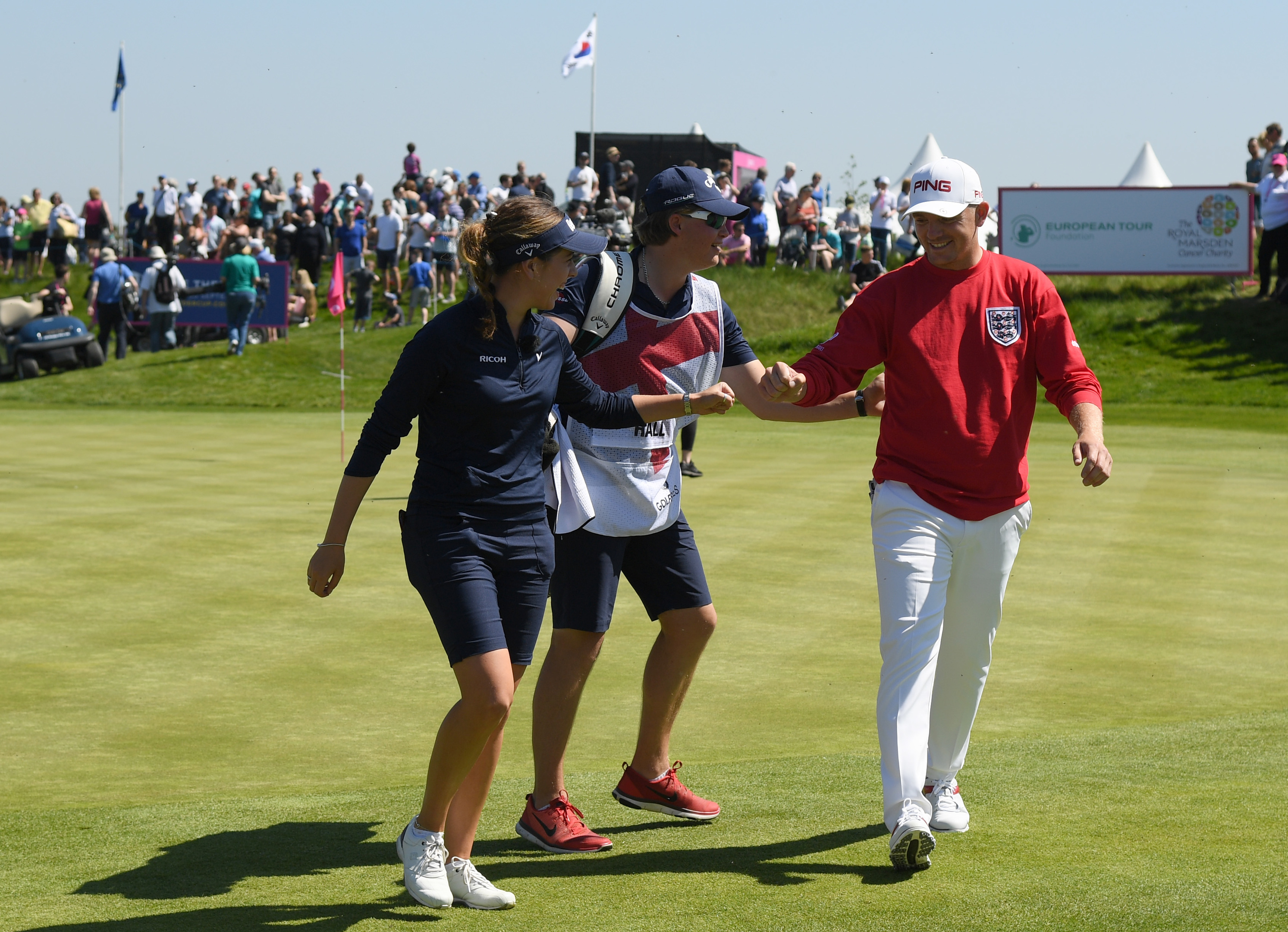 Georgia Hall and Matt Wallace congratulate each other after their opening tie finished in a draw at GolfSixes. Both teams later progressed to the knockout stages.