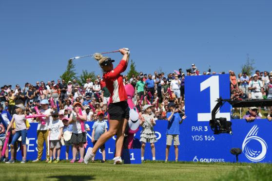 Charley Hull tees off in front of big crowds at the GolfSixes but England's women lost to eventual champions Ireland.