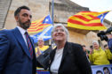 Clara Ponsati and her lawyer Aamer Anwar leave court in Edinburgh earlier this year.