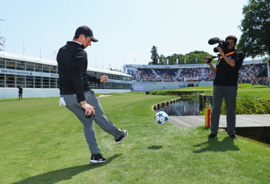 "Rory McIlroy takes part in a football golf challenge during the BMW PGA Championship Pro Am yesterday ""the first time I've kicked a ball since (my five a sides injury) in 2015"" he joked."