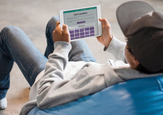 A young person using the Momo app.