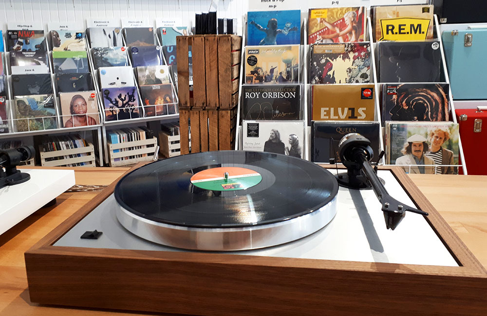 A record on a turntable within Assai's Dundee shop